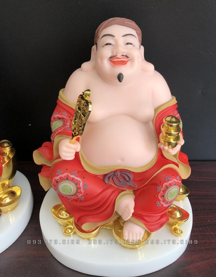 tượng ông địa thần tài bằng đá phủ gấm đỏ đẹp
